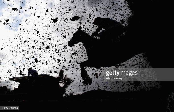 A horse and rider clear the last fence during the Betway Red Rum Handicap Steeple Chase at Aintree Racecourse on April 6 2017 in Liverpool England