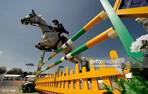 Horse and rider clearing fence obstacle during the 2008 Royal Windsor Horse Show, The Horse and Hounds Foxhunter, at The Private Grounds of Windsor...