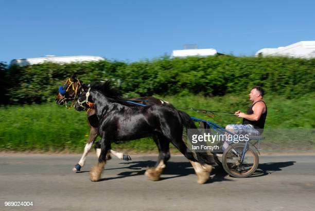 A horse and trap is driven along flashing lane on the first day of the Appleby Horse Fair on June 7 2018 in Appleby EnglandThe fair is an annual...
