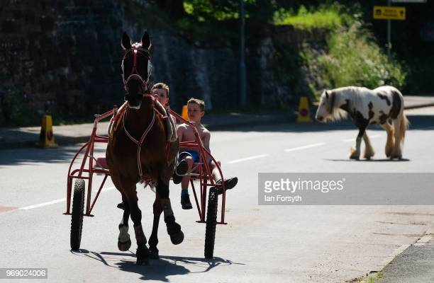 A horse and trap is driven through the town on the first day of the Appleby Horse Fair on June 7 2018 in Appleby EnglandThe fair is an annual...