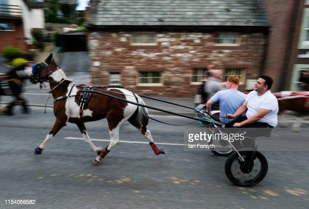 Horse and trap is driven through town on the first day of the Appleby Horse Fair on June 06, 2019 in Appleby, England. The fair is an annual...