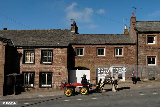 A horse and trap is driven through town on the first day of the Appleby Horse Fair on June 7 2018 in Appleby EnglandThe fair is an annual gathering...