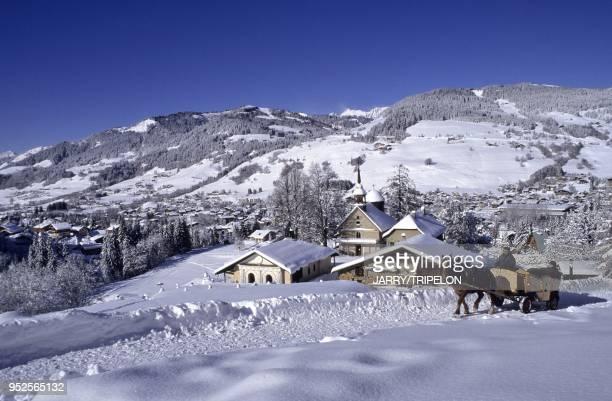 Horse barouche or sleigh rides on the Chemin du Calvaire path, Megeve ski resort, Mont-Blanc mountain area, Haute-Savoie department, Rhone-Alpes...
