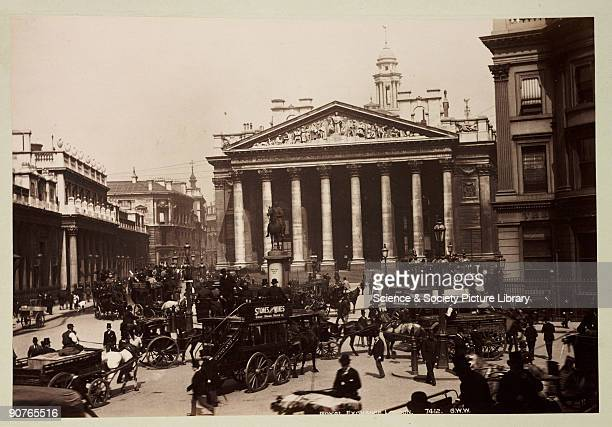 Horse buses in the foreground with an equestrian statue of the Duke of Wellington outside the Exchange A photograph from an album of sixty...
