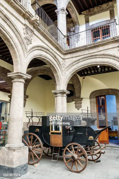 A horse carriage in the central courtyard at the Museum of the City of Mexico