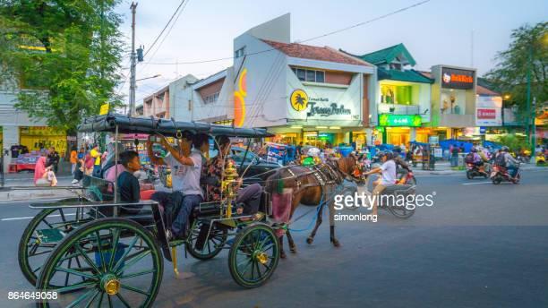 horse carriage in yogyakarta,indonesia - yogyakarta stock photos and pictures