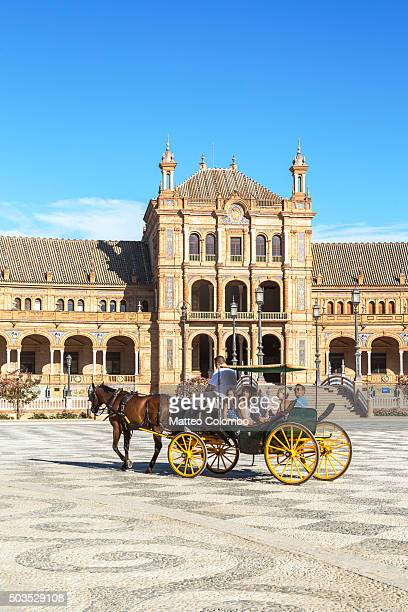 horse carriage with tourists, plaza de espana, seville, andalusia, spain - seville stock pictures, royalty-free photos & images