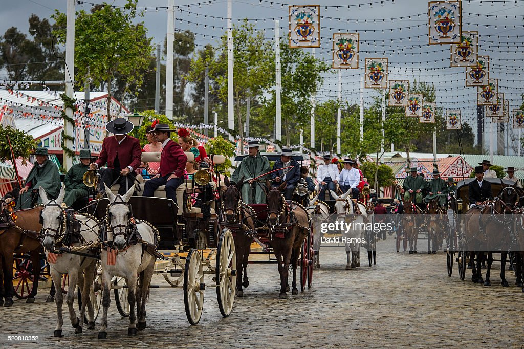 Horse carriages make their way on the street at the Feria de Abril (April's Fair) on April 12, 2016 in Seville, Spain. The Feria de Abril has a history that dates back to 1857 and takes place a fortnight after Easter each year. The origin of the fair was a cattle market but the event quickly turned its goal from commerce to having fun. More than 1 million local and international participants are expected to attend the Feria de Abril.