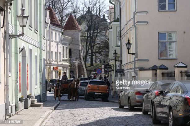 Horse cart going by the Old town street is seen in Tallinn Estonia on 30 April 2019