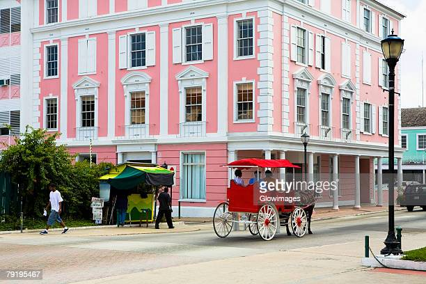 horse cart moving on the road, bay street, nassau, bahamas - nassau stock photos and pictures