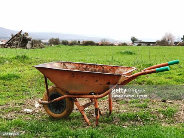 horse cart on field against sky - wheelbarrow stock pictures, royalty-free photos & images