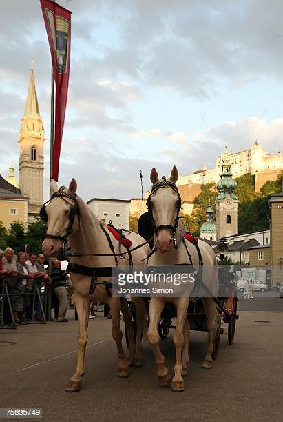 Horse coach crosses in front of the Salzburg festival halls prior to the opening concert of Salzburg summer festival on July 27, 2007 in Salzburg,...