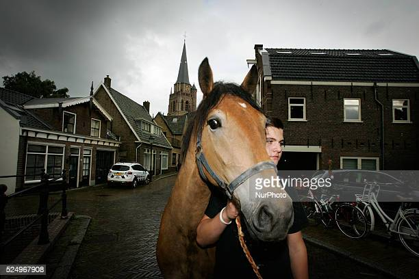 VOORSCHOTEN Horse dealers and their sticks used to keep the animals in place and calm Every year on the 28th of July a horse market is held The...
