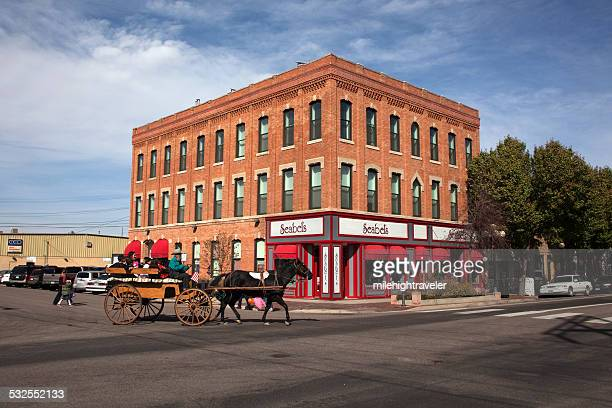 Horse drawn carriage and shops Pueblo Colorado