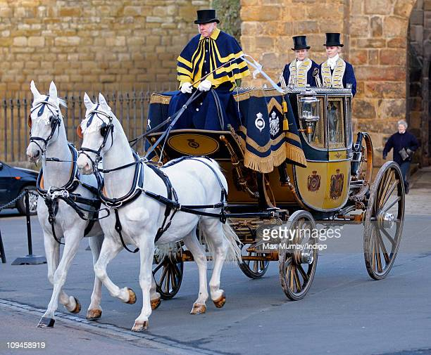 A horse drawn carriage carries Lady Katie Percy and her father Ralph Percy The Duke of Northumberland to her wedding at St Michael's Church on...
