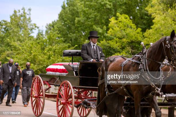 A horse drawn carriage carrying the body of civil rights icon former US Rep John Lewis crosses the Edmund Pettus Bridge on July 26 2020 in Selma...