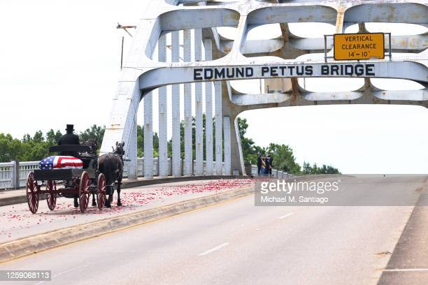 Horse drawn carriage carrying the body of civil rights icon, former US Rep. John Lewis crosses the Edmund Pettus Bridge on July 26, 2020 in Selma,...