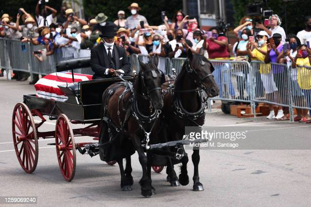 Horse drawn carriage carrying the body of civil rights icon, former US Rep. John Lewis prepares to cross the Edmund Pettus Bridge on July 26, 2020 in...