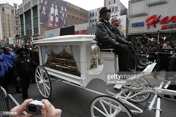 A horse drawn carriage carrying the casket of James Brown arrives at a viewing of his body at the Apollo theater on December 28 2006 in New York City
