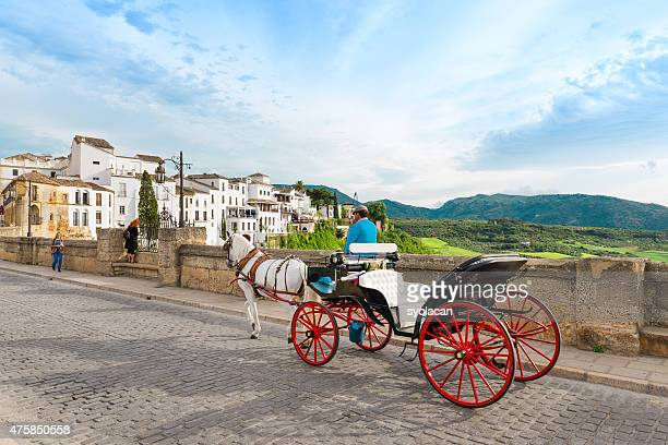 horse drawn carriage on puerto nuveo in ronda - syolacan stock pictures, royalty-free photos & images