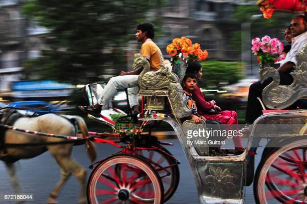 Horse drawn carriage on the busy streets of Mumbai, Maharashtra, India