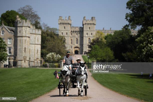Horse drawn cart carries tourists along The Long Walk at Windsor Castle as it prepares for the wedding of Prince Harry and his fiance US actress...