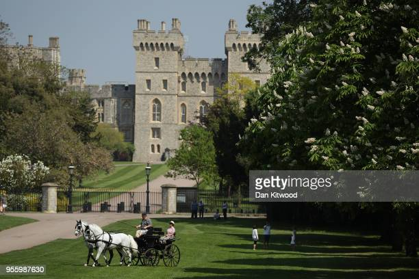A horse drawn cart carries tourists along The Long Walk at Windsor Castle as it prepares for the wedding of Prince Harry and his fiance US actress...
