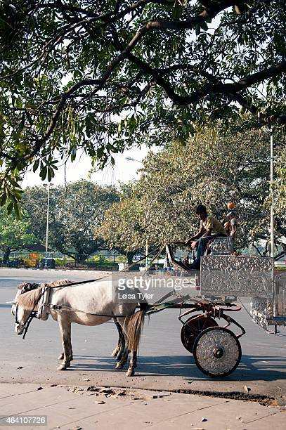A horse drawn chariot waits for rides outside Victoria Monument in Calcutta otherwise known as Kolkata Riding in a silver embellished chariot across...