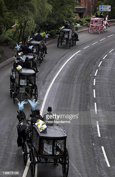 Horse drawn hearses travel to St Mary's Church carrying the coffins of the six Philpott children on June 22 2012 in Derby England Hundreds of people...
