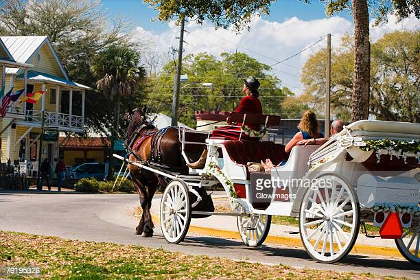 horse drawn on the road, st. augustine, florida, usa - st. augustine florida stock photos and pictures