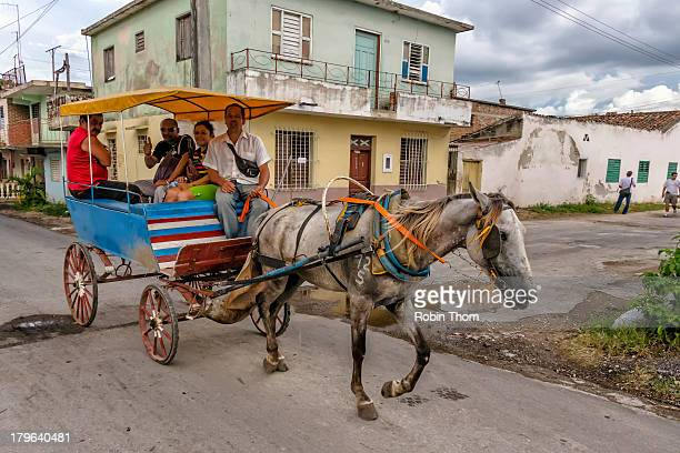 CONTENT] Horse drawn wagon busing people to the hospital in Holguin Cuba