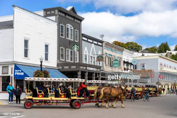 horse drawn wagon, mackinac island - mackinac island stock pictures, royalty-free photos & images