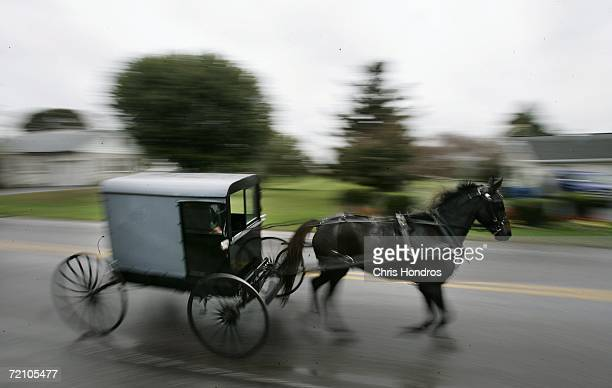 A horse draws an Amish carriage through Georgetown in Bart Township during the funeral of slain Amish schoolgirl Anna Mae Stoltzfus October 6 2006 in...