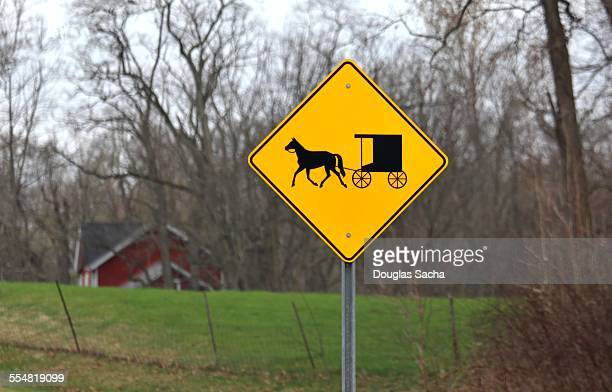 horse driven buggy roadway sign - lancaster county pennsylvania stock pictures, royalty-free photos & images