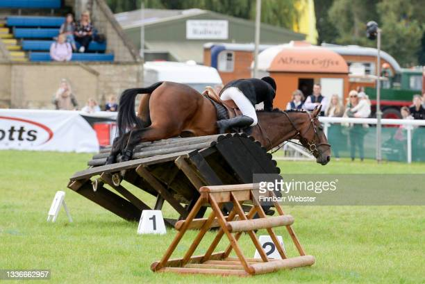 Horse gets its hooves caught in a jump during the Inter Hunt Relay competition on August 27, 2021 in Shepton Mallet, England. This year The Royal...