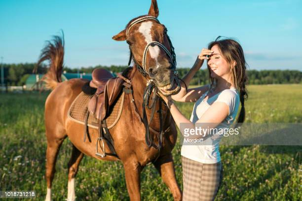 horse grins. woman and horse on joint walk - dressage horse russia stock photos and pictures