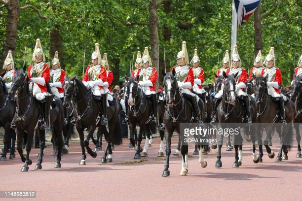 Horse Guards are seen marching as they take part in the Horse Guards Parade during the Trooping the Colour ceremony to marks the 93rd birthday of...