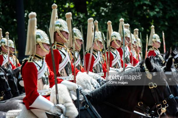 Horse Guards on the way to Buckingham Palace The ceremony of Trooping the Colour is believed to have first been performed during the reign of King...