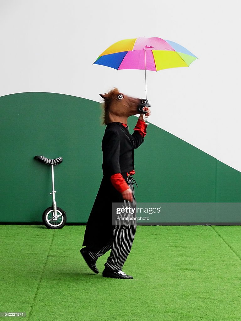 Horse Headed Clown With Colorful Umbrella Stock Photo   Getty Images