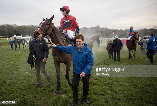 A horse is led into the parade ring after the Welsh Grand National Handicap Steeple Chase during the 2016 Coral Welsh Grand National at Chepstow...