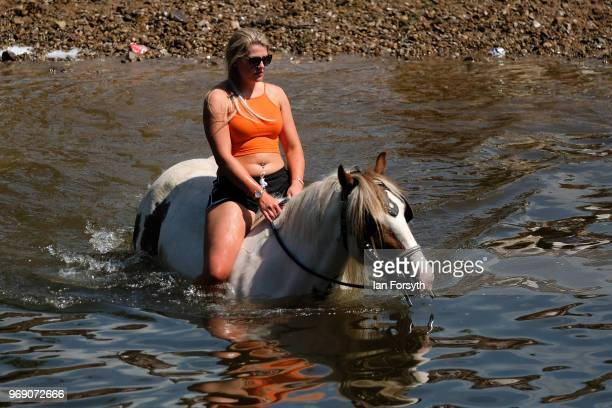 A horse is ridden out of the River Eden after being washed on the first day of the Appleby Horse Fair on June 7 2018 in Appleby EnglandThe fair is an...