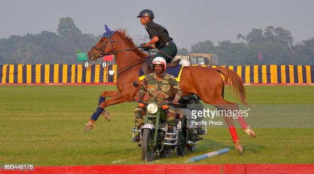 A horse jumps over two motorcycles The Indian army exhibits their skills during the 'Vijay Diwas' celebration The Indian army celebrates its 46th...