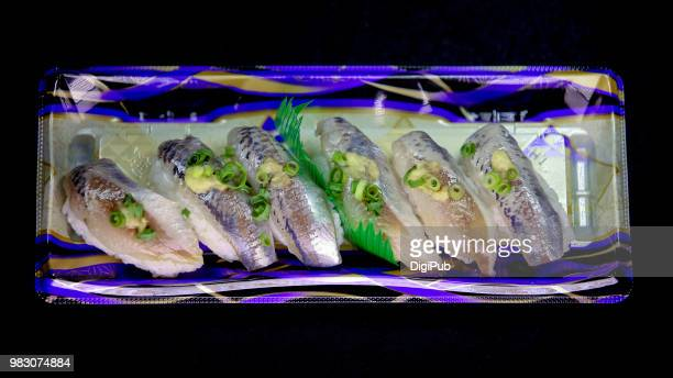 horse mackerel sushi in disposable plastic tray on black background - jack fish stock pictures, royalty-free photos & images