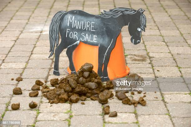 Horse manure for sale sign Manure for sale sign in a stable yard