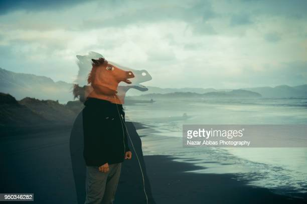 Horse mask man with double exposure.