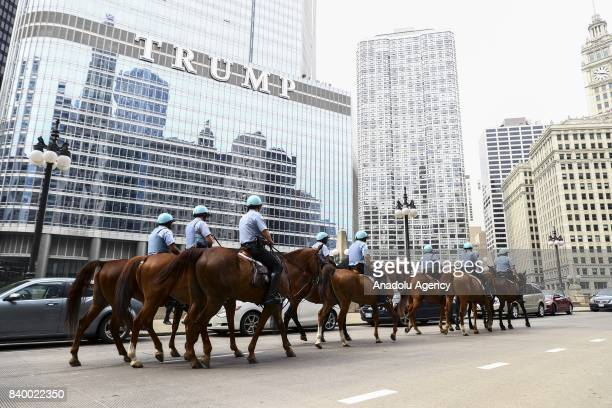 A horse mounted unit passes in front of Trump Tower during a protest against racism and hate in Chicago United States on August 27 2017 People from...