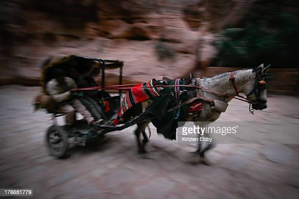 Horse pulling a buggy transports weary travellers from one end of Petra's Siq to the other. Riding horses, camels or donkeys through the Siq is not...