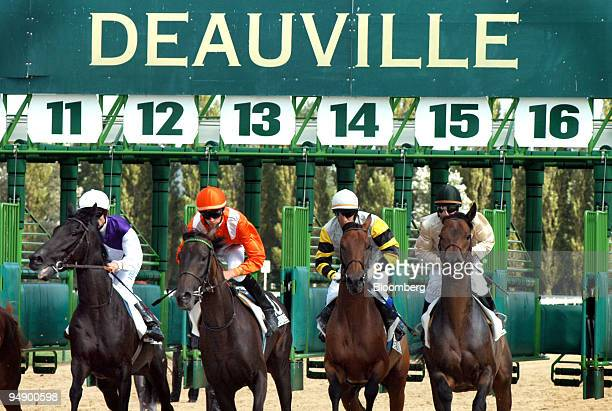 Horse race begins at the Deauville horse auction, Tuesday, August 23, 2005. The Deauville thoroughbred auction, a French tradition that has produced...