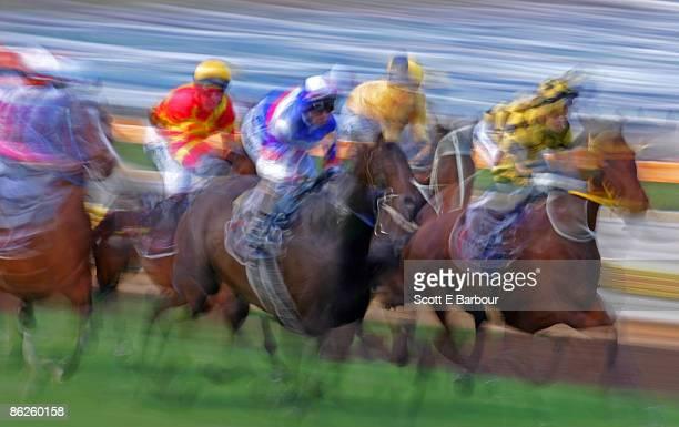 Horse race. Jockeys riding horses, blurred motion