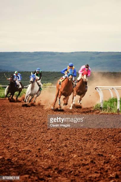 horse race on field against clear sky - jockey fotografías e imágenes de stock